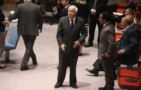 Palestinian Ambassador to the United Nations Mansour stands in the U.N. Security Council chamber before a Security Council meeting on the situation in the Middle East, at U.N. headquarters in New York