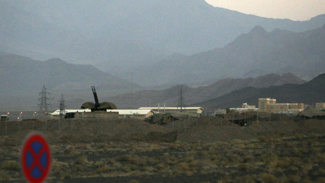 """FILE - In this Sept. 2007 file picture an anti-aircraft gun position is seen at Iran's nuclear enrichment facility in Natanz, Iran. The U.N. nuclear agency said Wednesday Sept. 2, 2011  it is """"increasingly concerned"""" about a stream of intelligence information suggesting that Iran continues to work secretly on developing a nuclear payload for a missile and other components of a nuclear weapons program. In its report, the International Atomic Energy Agency said """"many member states"""" are providing evidence for that assessment, describing the information it is receiving as credible, """"extensive and comprehensive.""""  The report was made available Friday to The Associated Press, shortly after being shared internally with the 35 IAEA member nations and the U.N. Security Council.   (AP Photo/Hasan Sarbakhshian, File)"""