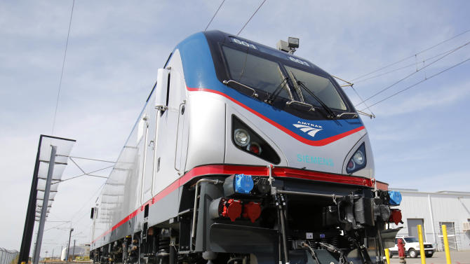 In this photo taken Saturday, May 11, 2013, is one of the new Amtrak Cities Sprinter Locomotives built by Siemens Rails Systems in Sacramento, Calif.  The new electric locomotive, one of three of 70 to be built,  will run on the Northeast intercity rail lines and  replace Amtrak locomotives that have been in service for 20 to 30 years.(AP Photo/Rich Pedroncelli)