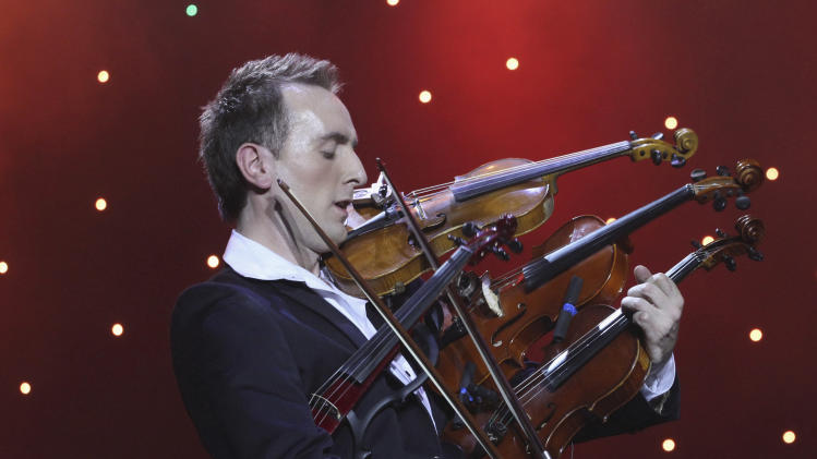 Ukrainian violinist Bozhyk plays four violins as he attempts new Guinness world record in Lviv