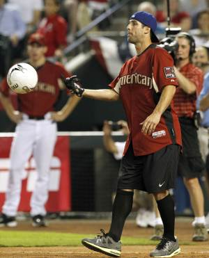 U.S. National Team Soccer player Carlos Bocanegra prepares to kick a soccer ball during the All Star Celebrity Softball game Sunday, July 10, 2011, in Phoenix. (AP Photo/Ross D. Franklin)