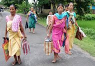 Bodo tribal people flee their homes in Kokrajhar district near Guwahati, in Assam state during violent clashes on July 23. New clashes took the death toll from ethnic violence in India's remote northeast to 22 on Tuesday despite an official curfew backed by shoot-on-sight orders, police said