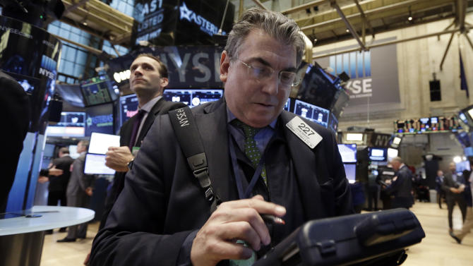 Trader John Bishop works on the floor of the New York Stock Exchange, Thursday, March 5, 2015. U.S. stocks opened higher on Thursday, led by gains for utilities and health care companies.  (AP Photo/Richard Drew)