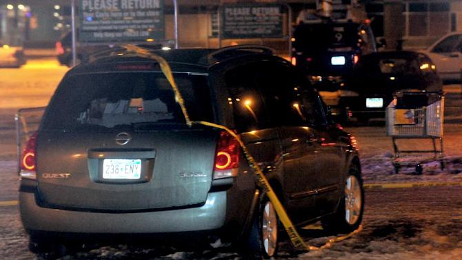 A minivan with a shot out back window sits in the parking lot of a Rainbow Food in Oakdale, Minn. on Monday, Feb. 11, 2013.  Oakdale police say a 34-year-old Oakdale man opened fire randomly at passing vehicles near a Rainbow Foods store about 6:10 p.m. Monday. The boy and his 39-year-old mother were struck in one vehicle. A 68-year-old woman in another vehicle was shot in the hand. All were taken to Regions Hospital. Stark says the boy died of his injuries. The women are expected to recover.  The suspect was arrested several blocks away Monday evening, Feb. 11, 2013. (AP Photo/Pioneer Press, Ginger Pinson) MINNEAPOLIS STAR TRIB OUT, MAGS OUT, MANDATORY CREDIT