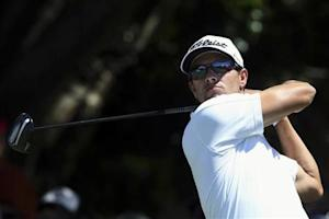 Australia's Scott hits on the tenth hole during the fourth round of the Australian Open golf tournament at Royal Sydney Golf Club