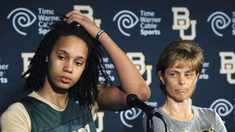 Baylor's Brittney Griner, left, and head coach Kim Mulkey, right, listen during a news conference in Waco, Texas, Thursday, March 29, 2012. Baylor will play Stanford  in an NCAA tournament women's Final Four semifinal college basketball game on Sunday. (AP Photo/Waco Tribune Herald, Rod Aydelotte)