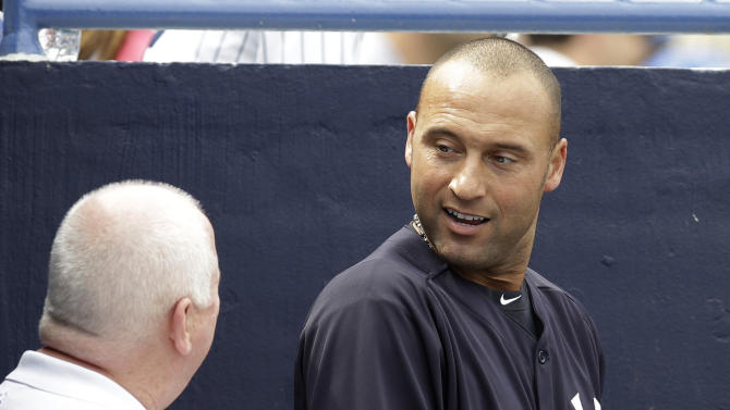 New York Yankees shortstop Derek Jeter talks with Yankees trrainer Steve Donohue after batting as the designated hitter in a spring training baseball game against the Altanta Braves at Steinbrenner Field in Tampa, Fla., Saturday, March 9, 2013.  (AP Photo/Kathy Willens)