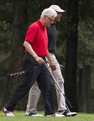 President Barack Obama, right, plays golf with former President Bill Clinton at Andrews Air Force Base on Saturday, Sept. 24, 2011, in Andrews Air Force Base, Md.  (AP Photo/Evan Vucci)