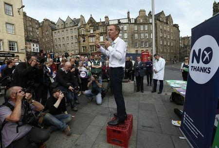 Labour MP Jim Murphy addresses a crowd during his tour to promote the case for Scotland to remain part of the United Kingdom