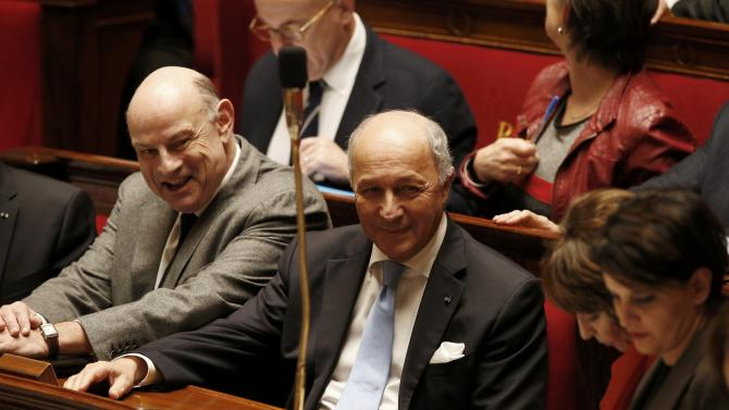 French Junior Minister for Parliamentary Relations Le Guen and Foreign Affair Minister Fabius attend the questions to the government session at the National Assembly in Paris