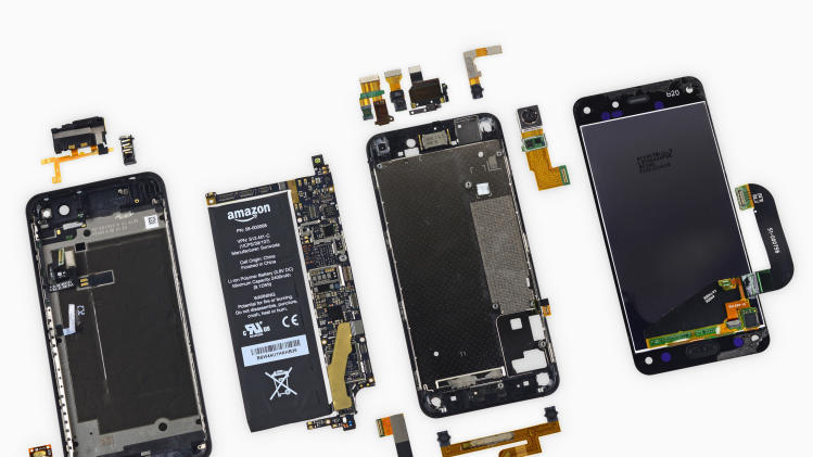 An Amazon Fire smartphone is seen opened up during a teardown procedure