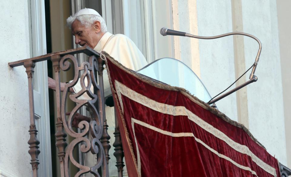 Pope Benedict XVI leaves after greetings faithful from his summer residence of Castel Gandolfo, the scenic town where he will spend his first post-Vatican days and made his last public blessing as pope,Thursday, Feb. 28, 2013. (AP Photo/Alessandra Tarantino)