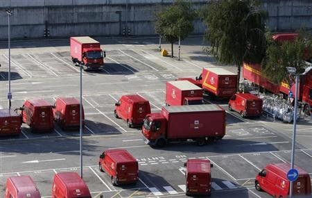Postal vans wait to be taken out on collection rounds at Mount Pleasant sorting office in London July 26, 2013. REUTERS/Olivia Harris