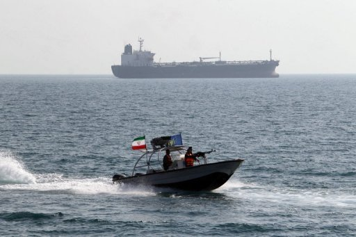 <p>File picture shows an Iranian Revolutionary Guards speedboat passing near an oil tanker at the port of Bandar Abbas. Iraq is helping its neighbor Iran skirt international sanctions by smuggling oil and letting Tehran secretly move large amounts of cash through bank auctions, The New York Times reported Sunday.</p>