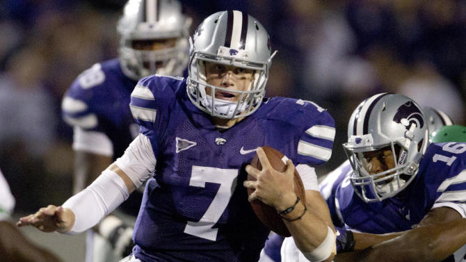 Kansas State quarterback Collin Klein (7) gets past North Texas linebacker Will Wright (11) during the second half of an NCAA college football game in Manhattan, Kan., Saturday, Sept. 15, 2012. (AP Photo/Orlin Wagner)