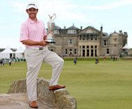 South African golfer Louis Oosthuizen stands on the Swilcan Bridge as he poses for pictures on July 19, 2010, with the Claret Jug after winning the 139th British Open Golf Championship at St Andrews in Scotland. The Scottish Government has added to the pressure on two of Scotland's most famous golf clubs to admit women as full members