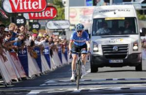 Garmin-Sharp team rider Andrew Talansky of the U.S.A cycles to cross the finish line of the 187.5-km 11th stage of the Tour de France cycling race