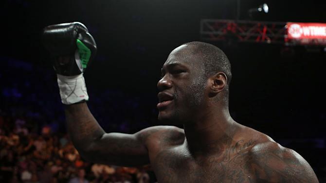 WBC Continental Americas Heavyweight Champion Deontay Wilder celebrates after defeating by KO in the first round Malik Scott during their heavyweight bout at the Ruben Rodriguez Coliseum in Bayamon, Puerto Rico, Saturday, March 15, 2014