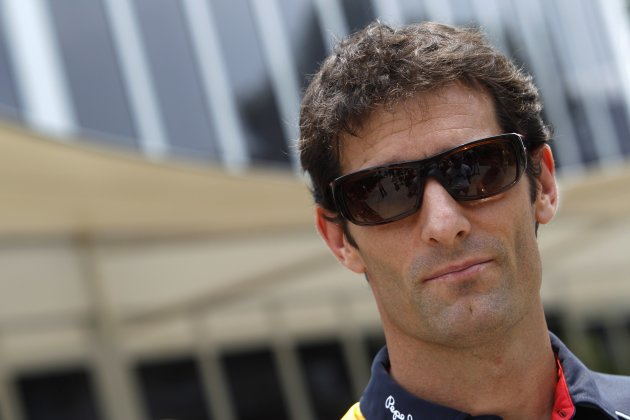 Red Bull F1 driver Webber of Australia looks on as he arrives in Sepang