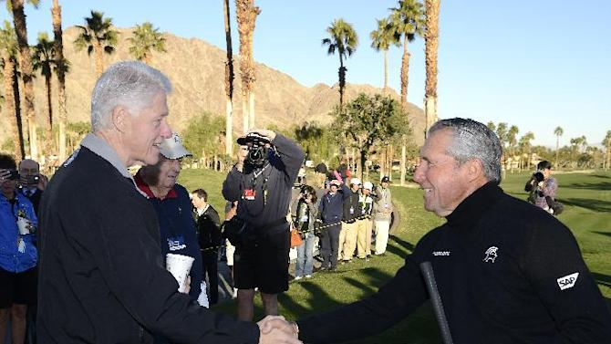 IMAGE DISTRIBUTED FOR HUMANA- Photos taken President Clinton, PGA Tour golfer Gary Player, golf legend Billy Casper and Humana's Mike McCallister on the first tee during the first day of the Humana Challenge on Jan. 17, 2013, at PGA West in La Quinta, Calif. The 2013 Humana Challenge is being held January 14-20 at PGA West in La Quinta, Calif. (Rodrigo Pena / AP Images for Humana)