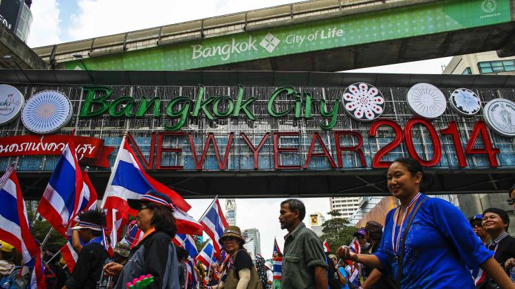 Anti-government protesters march during a rally at a major business district in Bangkok