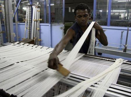 Textiles worker Rivo Rakotoarisoa from Madagascar works at a factory belonging to Ciel Textile near Balaclava