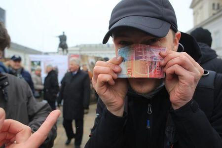 Polish holders of Swiss franc mortgages chide banks in Warsaw protest