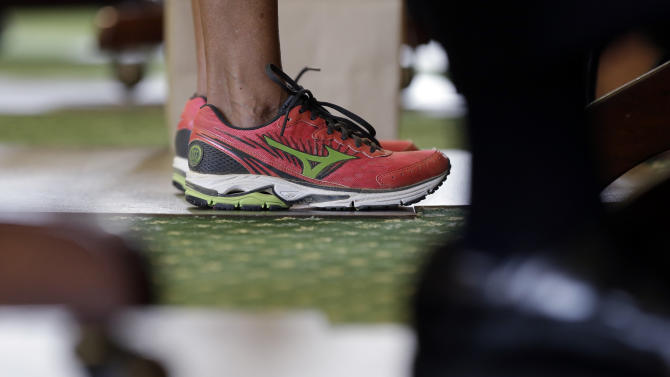 Sen. Wendy Davis, D-Fort Worth, wears tennis shoes in place of her dress shoes as she begins a one-woman filibuster in an effort to kill an abortion bill, Tuesday, June 25, 2013, in Austin, Texas. The bill would ban abortion after 20 weeks of pregnancy and force many clinics that perform the procedure to upgrade their facilities and be classified as ambulatory surgical centers. (AP Photo/Eric Gay)
