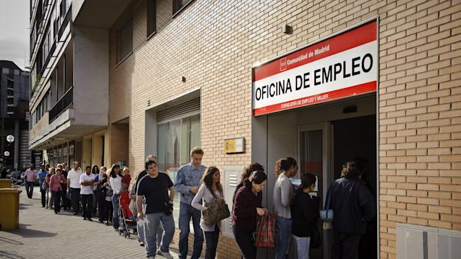 FILE - In this May, 28, 2010, file photo, people line up to enter a government job center in Madrid. According to a report released by the Associated Press in January 2013, of the 17 European countries that use the euro as their currency, almost 4.3 million low-pay jobs have been gained since mid-2009, but the loss of mid-pay jobs has never stopped. A total of 7.6 million disappeared from January 2008. (AP Photo/Daniel Ochoa de Olza, File)