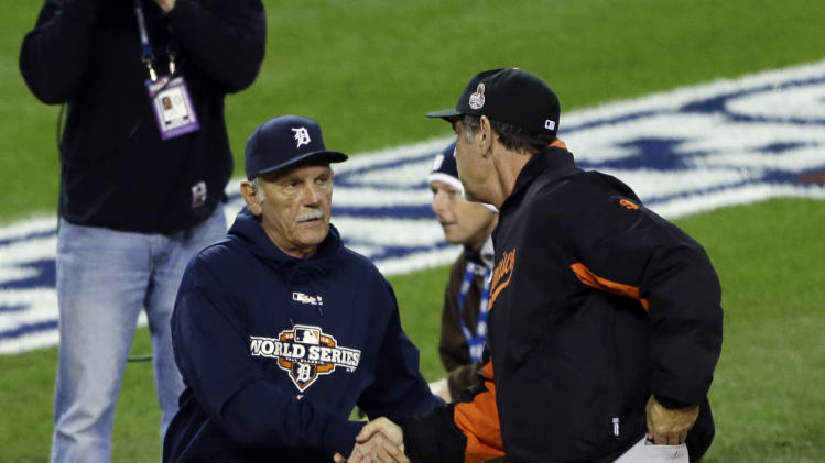 Detroit Tigers manager Jim Leyland, left, shakes hands with San Francisco Giants manager Bruce Bochy before Game 3 of baseball's World Series Saturday, Oct. 27, 2012, in Detroit. (AP Photo/Paul Sancya )