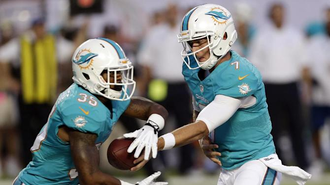 Devlin helps Dolphins beat Saints 24-21