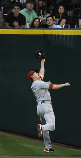 Reds send Astros to 7th straight loss with 4-1 win