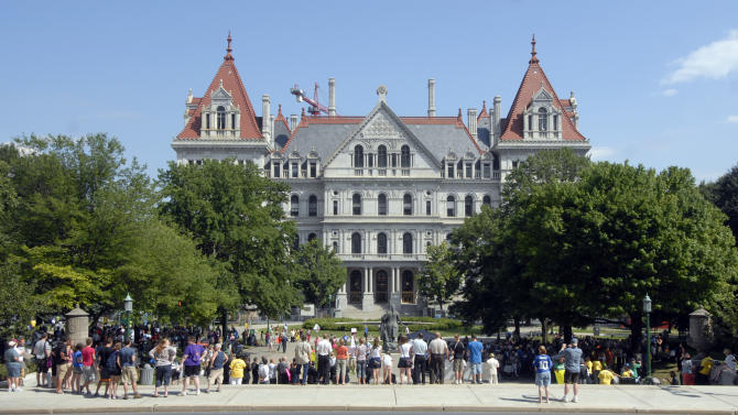Protesters take part in a Let The People Vote protest rally against same-sex marriage's at the state Capitol in Albany, N.Y., Sunday, July 24, 2011. (AP Photo/Hans Pennink)