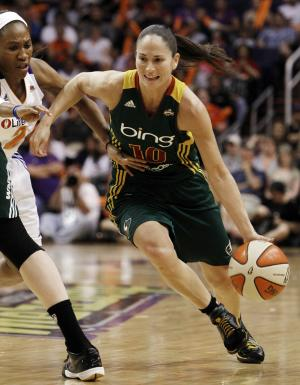 FILE - In this Sept. 17, 2011 file photo, The Phoenix Mercurys' Temeka Johnson, left, tries to defend the Seattle Storms' Sue Bird during a first round WNBA playoff basketball game in Phoenix. Bird will have her fourth in six years in early May to remove a cyst from her right knee. (AP Photo/Ross D. Franklin, File)