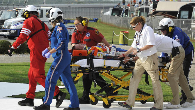 Authorities transport Eric McClure to a medical helicopter after a multi-vehicle wreck during the NASCAR Nationwide Series auto race at Talladega Superspeedway, Saturday, May 5, 2012, in Talladega, Ala. (AP Photo/Rainier Ehrhardt)