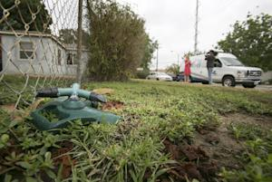 A lawn sprinkler is seena at the Whitney's home…