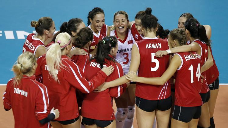 Players of Turkey celebrate their victory over Brazil in their FIVB Women's Volleyball World Grand Prix 2014 final round match in Tokyo