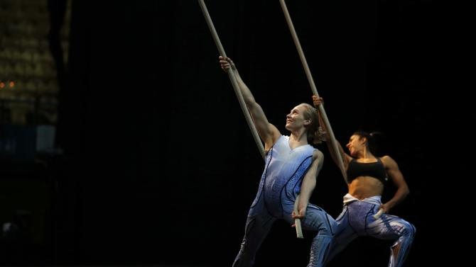 Performers from Cirque du Soleil's show 'Quidam' practice backstage before a show at the MEO Arena in Lisbon