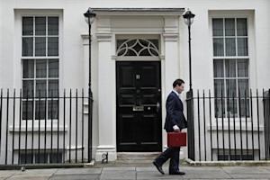 Britain's Chancellor of the Exchequer, George Osborne, walks away from number 11 Downing Street, before delivering his budget to the House of Commons, in central London