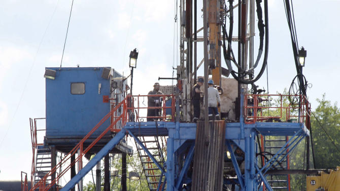 FILE - In this June 25, 2012 file photo, a crew works on a gas drilling rig at a well site for shale based natural gas in Zelienople, Pa. It sounds like a free-market success story: a new gas drilling boom driven by hydraulic fracturing, or fracking, which delivers a vast new source of cheap energy without the government subsidies that solar and wind power demand. But men who helped pioneer fracking recall a different story. From the shale fields of Texas and Wyoming to the Marcellus in the northeast, the U.S. Department of Energy contributed more than $100 million in direct federal research to help develop fracking, and Congress added $10 billion in tax breaks. Now, some of the biggest supporters of shale gas say the government should continue to back renewable energy research - for decades, if need be - to deliver future breakthroughs in that field. (AP Photo/Keith Srakocic)