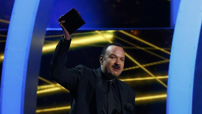 "Pepe Aguilar accepts the award for best ranchero album for "" Lastima que sean ajenas"" at the15th Annual Latin Grammy Awards in Las Vegas"