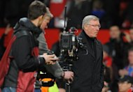 Manchester United manager Alex Ferguson leaves the pitch after his team's Europa League round of 32 second leg match defeat against Ajax at Old Trafford in Manchester, north-west England, on February 23. Fergie saw his team beaten 2-1 but a 2-0 first leg lead carried United through in nervy fashion