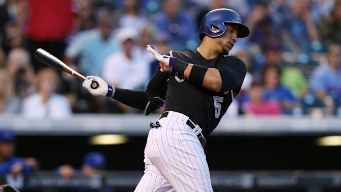 Gonzalez homers as Rockies rout Cubs, 13-4
