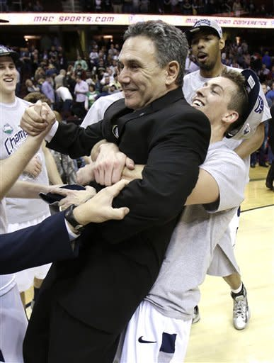 Akron downs Ohio 65-46 to win MAC title