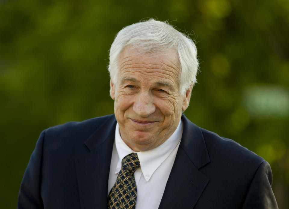 FILE - This April 5, 2012 file photo shows Jerry Sandusky arriving at the Centre County Courthouse in Bellefonte, Pa. Sandusky, facing trial next week on charges he sexually abused 10 boys, on Thursday asked a state appeals court to review his case and to delay the criminal proceedings against him. (AP Photo/Matt Rourke, File)