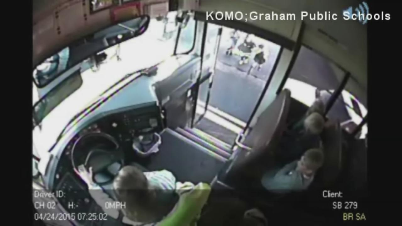VIDEO: Students nearly hit by speeding SUV while getting on school bus