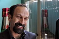 "Iranian director Asghar Farhadi, pictured here in April 2012, who won this year's foreign-language picture Academy Award, claimed a prize at Cannes Sunday to help fund his next film, with fellow Oscar-winner Marion Cotillard. Farhadi, who made the wrenching family drama ""A Separation"", accepted the European Union's Prix Media with a 60,000-euro ($77,000) cash award"