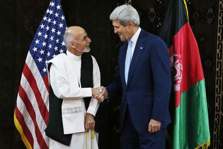 U.S. Secretary of State Kerry shakes hands with Afghanistan's presidential candidate Ghani at the start of a meeting at the U.S. embassy in Kabul