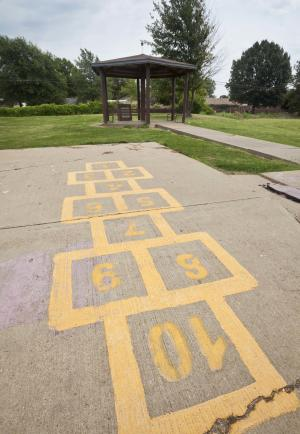 In this photo taken Aug. 13, 2012, a gazebo built in honor of three Cub Scouts murdered in 1993, sits on a playground behind the school the boys attended in West Memphis, Ark. Three men known as the West Memphis Three were released from prison last year after years of questions about the evidence in the case. (AP Photo/Danny Johnston)