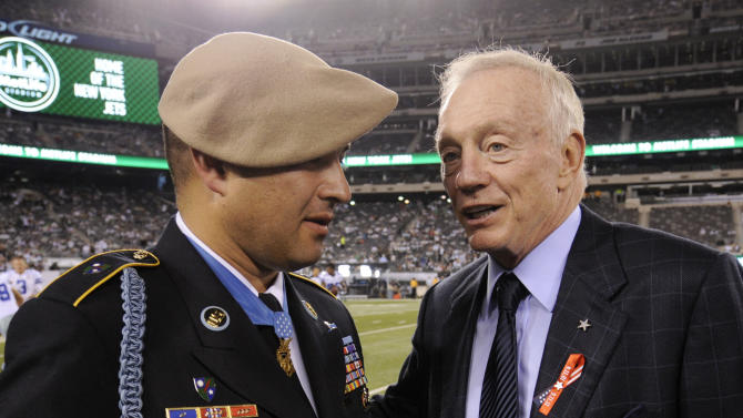 Jerry Jones, owner and general manager of the Dallas Cowboys, right, speaks with Medal of Honor recipient Army Ranger Leroy Petry, of New Mexico, before an NFL football game between the Dallas Cowboys and the New York Jets Sunday, Sept. 11, 2011,  in East Rutherford, N.J. (AP Photo/Henny Ray Abrams)
